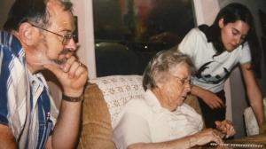 Stuart Davis, Mary (Davis) Russell, Michelle Davis Sinclair pouring over family history.