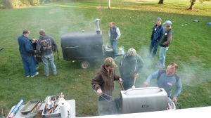 How many Presbyterian men does it take to grill a few hamburgers, veggie burgers and hot dogs these days?