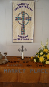 New banner made by lifelong friends Susan, Ginny and Page. Altar cloth is one of Trinity's first ever banners of burlap, for the Marketplace House Church which ran a coffee house near Court Square in Harrisonburg for many years.